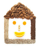 Funny smiling house made of seeds Royalty Free Stock Photos