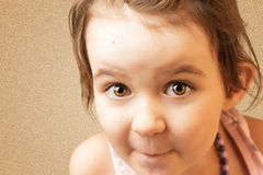 Funny smiling kid. On brown background Royalty Free Stock Images