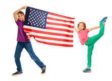 Funny smiling kids waving American flag Royalty Free Stock Image