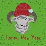 Funny smiling lamb in a red hat Royalty Free Stock Photos