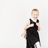 Funny smiling little girl with big backpack jumping and having f Royalty Free Stock Photos