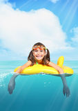 Funny smiling little girl with diving glasses floating inflatabl Royalty Free Stock Photography