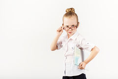 Funny Smiling Little Girl Imitates A Strict Teacher Against Whit Royalty Free Stock Image