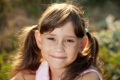 Funny smiling little girl with tails Royalty Free Stock Photo
