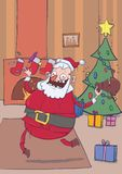 Funny smiling Santa Claus brings gifts and throws candies in the air. Christmas decorated room with fireplace, stockings. Funny smiling Santa Claus brings gifts Royalty Free Stock Photography