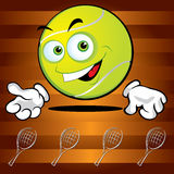 Funny smiling tennis ball. On the broun background Royalty Free Stock Images