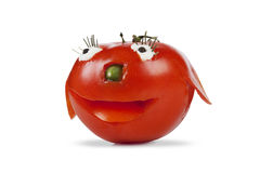 Funny smiling tomato. Isolated on a white background Royalty Free Stock Photo