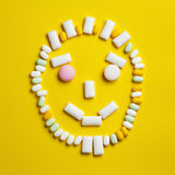Funny smily face made of chewing gums Stock Images