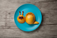 Funny snail made of juicy fruits Royalty Free Stock Photo
