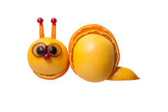 Funny snail made of orange, grape Royalty Free Stock Photography