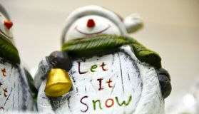 Funny snow man with text let it snow, winter concept. Image,high iso noise stock photos