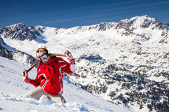 Funny snowboarder. Girl snowboarder on the mountain top Royalty Free Stock Image