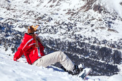 Funny snowboarder. Girl snowboarder on the mountain top Royalty Free Stock Photography
