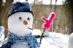 Funny snowman. Snowman with a hat and scarf Stock Photography
