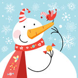 Funny snowman with bird. Funny big snowman with a bird on a background with snowflakes Stock Photo