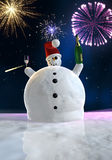 Funny snowman is celebrating. Frozen snowman drink champagne with fireworks in background Royalty Free Stock Photos