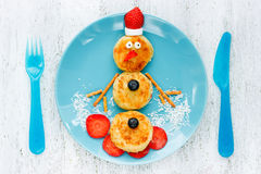Funny snowman Christmas morning breakfast pancakes for kids Stock Photo
