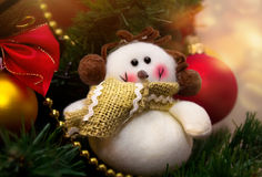 Funny snowman decoration on Christmas tree background Stock Photography