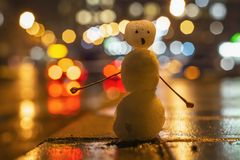 Funny snowman hitchhiker, blurred background. February stock photos