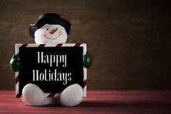 Snowman and text happy holidays Stock Photos