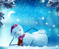 Funny snowman   lying in the snow. Merry Christmas and happy New Year greeting card with copy-space. Funny snowman   lying in the snow.Winter Christmas landscape Royalty Free Stock Photo