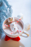 Funny snowman made of marshmallows for xmas Royalty Free Stock Photo