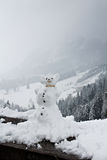Funny snowman in mountains Stock Images