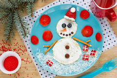 Funny snowman pancake for breakfast - Christmas fun food art ide Royalty Free Stock Images