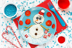 Funny snowman pancake for breakfast - Christmas fun food art ide Royalty Free Stock Photos