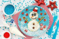 Funny snowman pancake for breakfast - Christmas fun food art ide Stock Photography