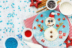 Funny snowman pancake for breakfast - Christmas and New Year fun Stock Photo