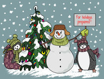 Funny snowman and penguin hand drawn cartoon style near a Christmas tree waiting for the onset of the holiday. Royalty Free Stock Image