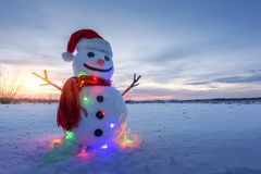 Funny snowman in red hat Stock Images