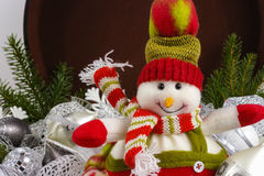 Funny snowman sits on vintage brouwn coffer with white christmas Royalty Free Stock Photos