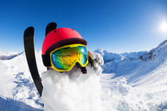 Funny snowman wearing safety helmet and mask Royalty Free Stock Image