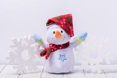 Free Funny Snowman With Big Snowflakes From Foam On A White Background Royalty Free Stock Photography - 125824287