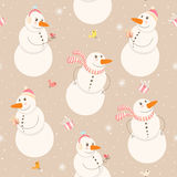 Funny Snowmen. Seamless winter pattern with snowmen on a beige background Royalty Free Stock Image