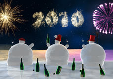 Funny snowmen are  drinking. Frozen snowmen drink champagne with fireworks in background Royalty Free Stock Photos