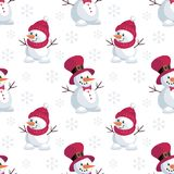 Funny snowmen pattern. Christmas seamless pattern with the image of snowmen in cartoon style. Vector colorful background Stock Photos