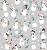 Funny snowmen s with buckets, boots, gloves, carrots and fir branches. In gray, white, orange, green and pink a seamless pattern on a gray background Stock Photo