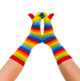 Funny Socks. Striped socks on cold feet playing in the air Royalty Free Stock Photos