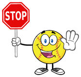 Funny Softball Cartoon Mascot Character Gesturing And Holding A Stop Sign Royalty Free Stock Images