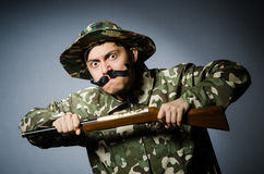 Funny soldier against Royalty Free Stock Photos