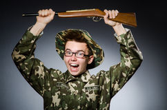 Funny soldier against Stock Photography