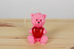 Funny Souvenir gift candles in the shape of teddy-bear with red Stock Photo