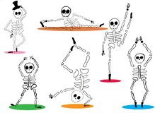 Funny spooky skeletons dancing on white background Royalty Free Stock Photography