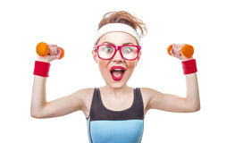 Funny sports woman with dumbbell. Close-up of fitness girl stock photography