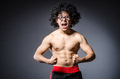 Funny sportsman sporting. His muscles Stock Photos