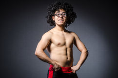 Funny sportsman sporting. His muscles Royalty Free Stock Photography