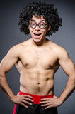 Funny sportsman sporting. His muscles Royalty Free Stock Photo